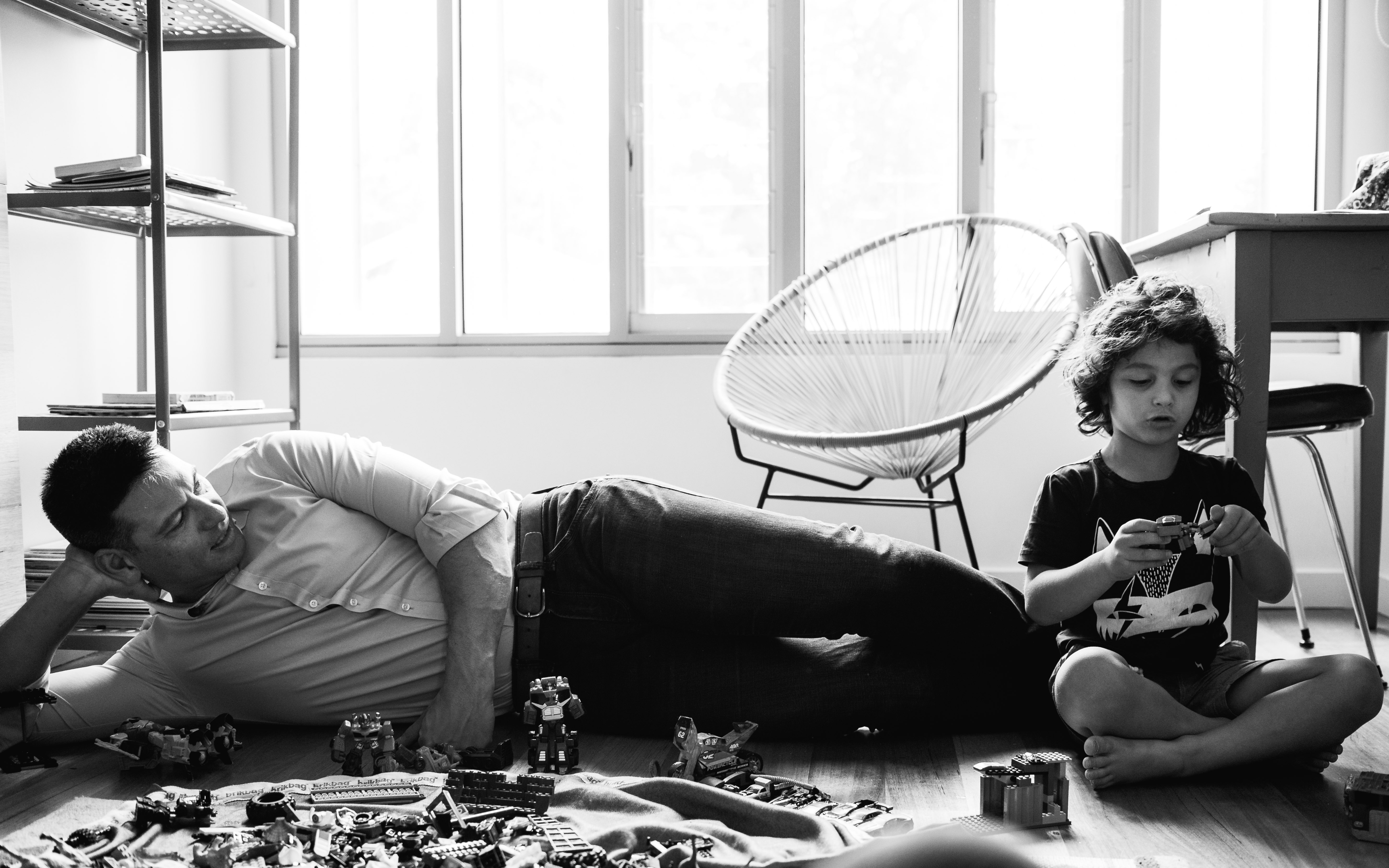 in-home session photograph of father and his boy creating and building with Lego in their bedroom in Carlton North, Melbourne, Australia