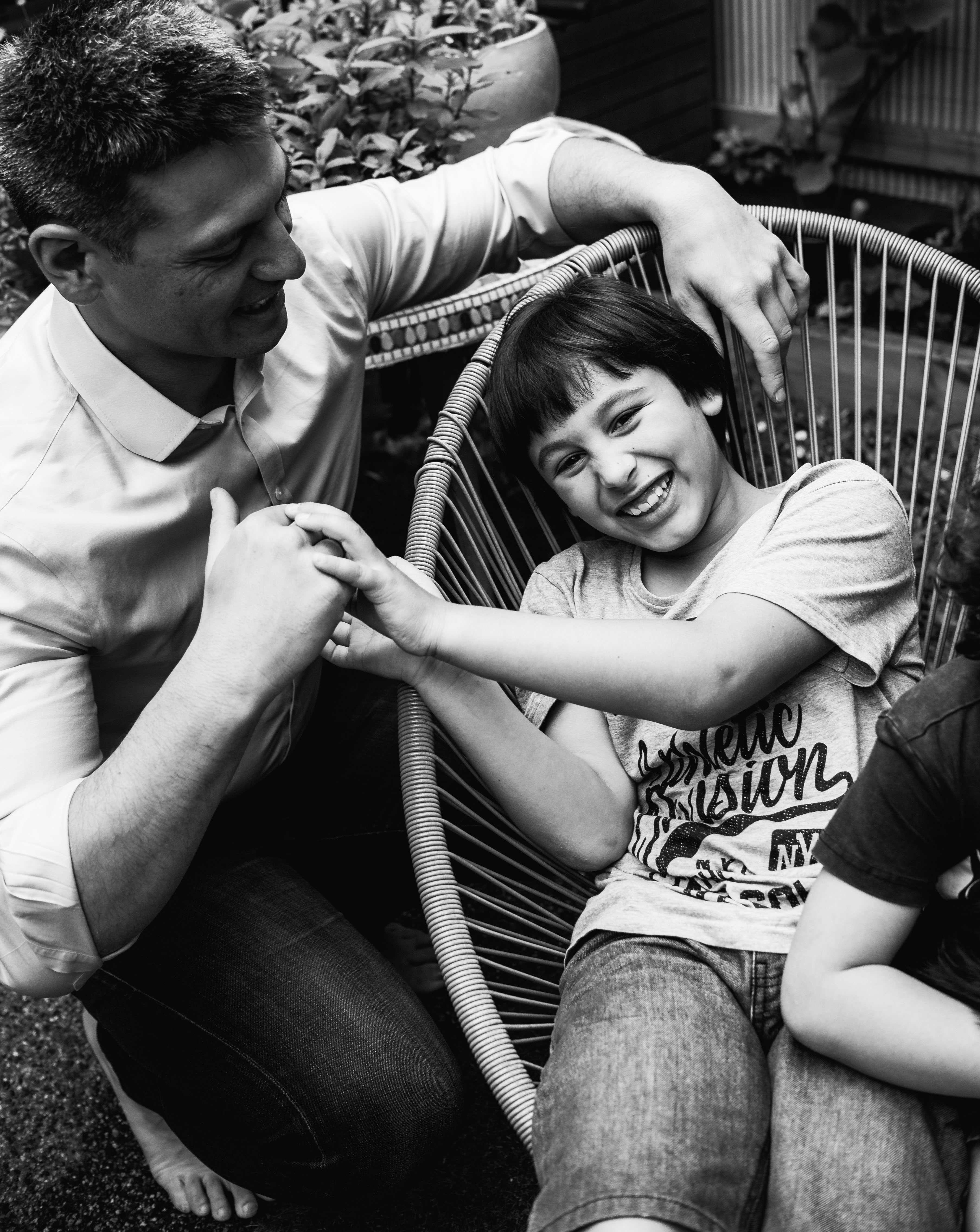 photograph of a boy getting tickled by his father in Carlton North, Melbourne, Australia