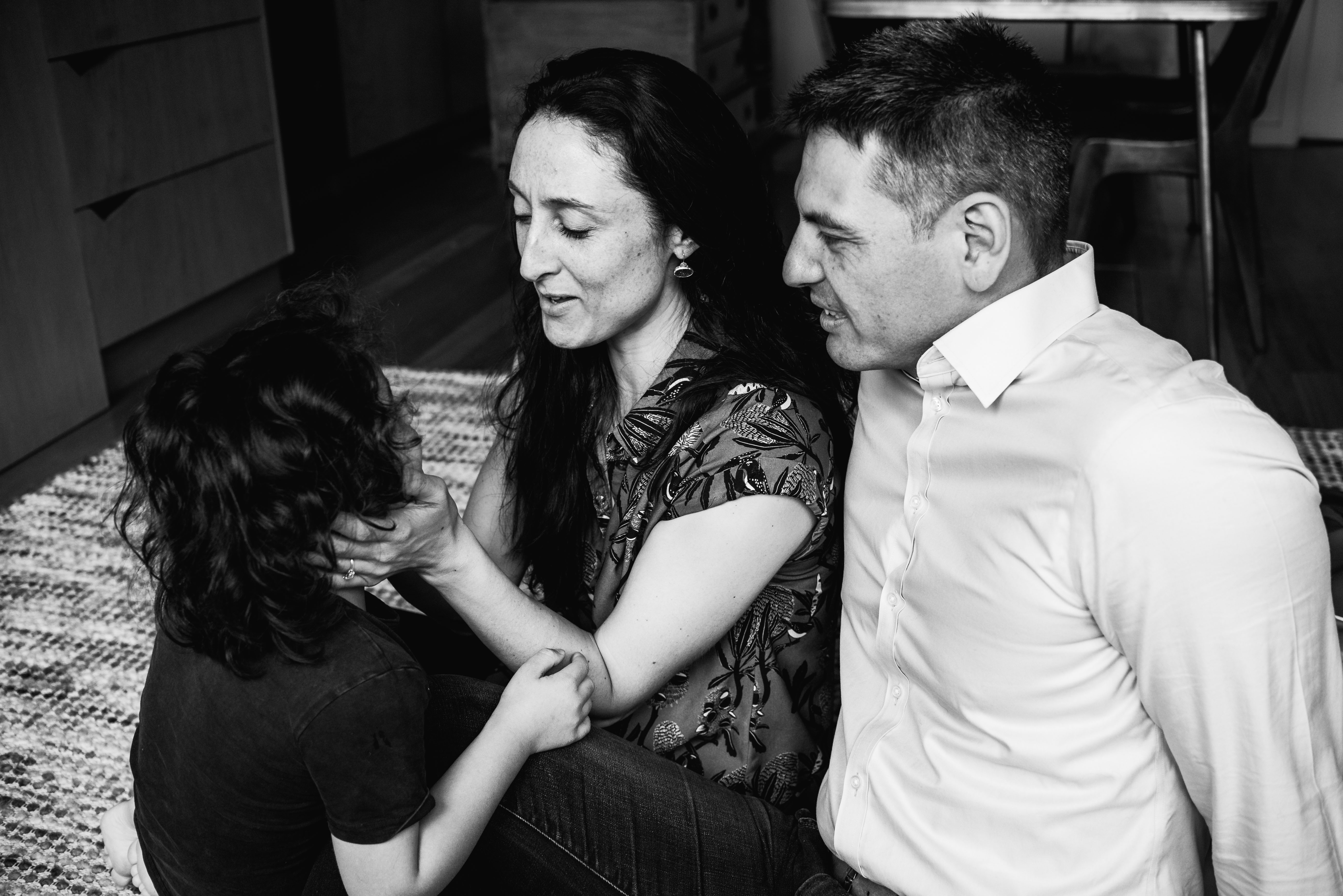 in-home session photograph of parents talking to their son in Carlton North, Melbourne, Australia